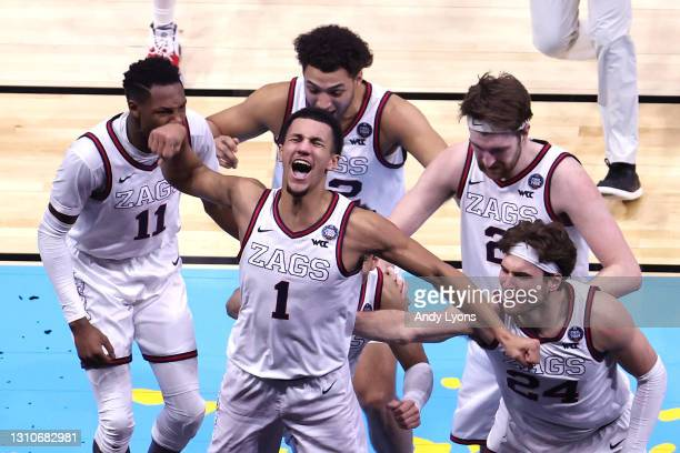 Jalen Suggs of the Gonzaga Bulldogs celebrates with teammates after making a game-winning three point basket in overtime to defeat the UCLA Bruins...
