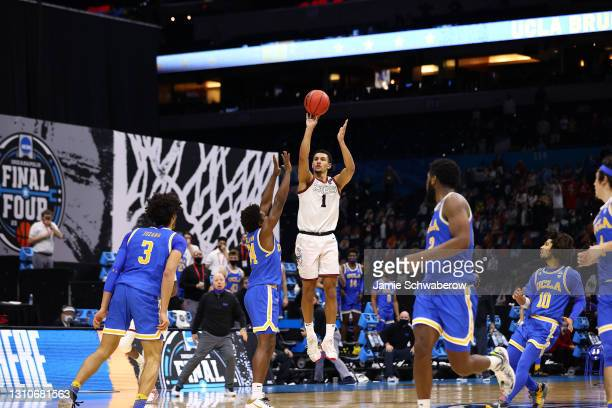 Jalen Suggs of the Gonzaga Bulldogs makes a last-second shot over David Singleton of the UCLA Bruins to win in overtime in the Final Four semifinal...