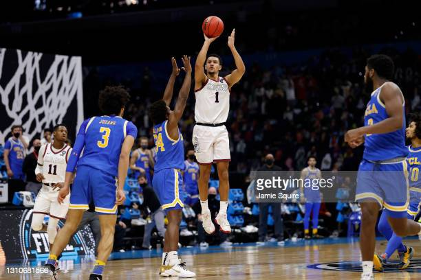 Jalen Suggs of the Gonzaga Bulldogs shoots a game-winning three point basket in overtime to defeat the UCLA Bruins 93-90 during the 2021 NCAA Final...