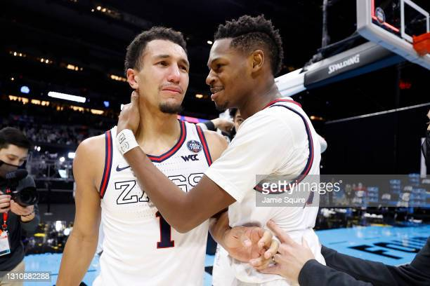 Jalen Suggs reacts with Joel Ayayi of the Gonzaga Bulldogs after defeating the UCLA Bruins 93-90 in overtime during the 2021 NCAA Final Four...