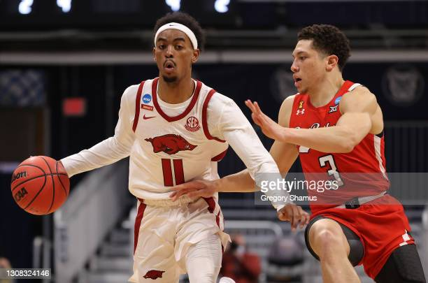 Jalen Tate of the Arkansas Razorbacks drives the ball as Clarence Nadolny of the Texas Tech Red Raiders defends during the first half in the second...