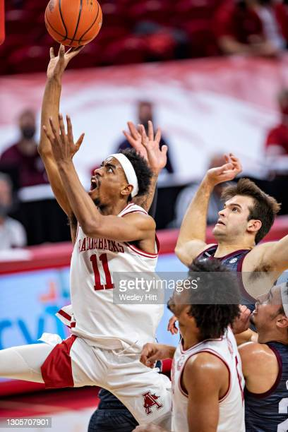 Jalen Tate of the Arkansas Razorbacks goes to the basket for a shot in the first half during a game against the Texas A&M Aggies at Bud Walton Arena...