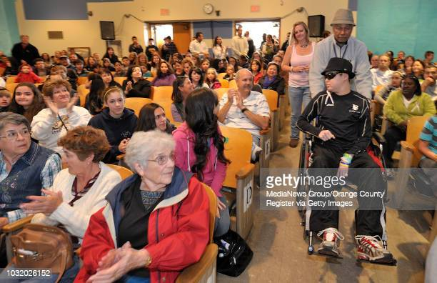 BEACH CALIF USA Jalen Thayer and his grandfather Matthew Thayer enter the auditorium at Patrick Henry School in Long Beach Calif on March 19 2011...