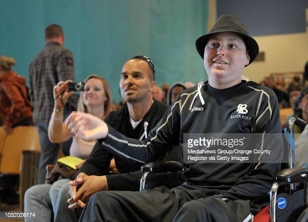 BEACH CALIF USA Jalen Thayer right with his parent Lance Thayer center and Jennifer Thayer at Patrick Henry School in Long Beach Calif on March 19...