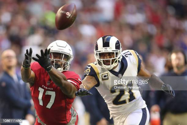 Jalen Tolliver of the Arizona Cardinals reaches for a pass in front of Aqib Talib of the Los Angeles Rams in the first half at State Farm Stadium on...