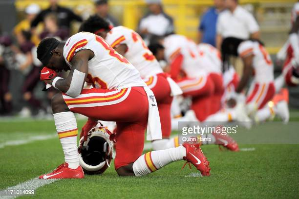 Jalen Tolliver of the Kansas City Chiefs kneels before a preseason game against the Green Bay Packers at Lambeau Field on August 29 2019 in Green Bay...