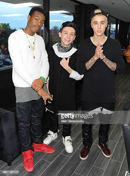Jalen Tucker Ryan Friedlinghaus Jr and singer Justin Bieger attend the Grand Opening of West Coast Customs Burbank Headquarters at West Coast Customs...
