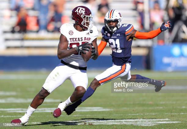 Jalen Wydermyer of the Texas A&M Aggies pulls in this reception against Smoke Monday of the Auburn Tigers during the second half at Jordan-Hare...