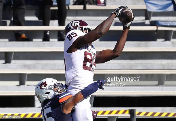 Jalen Wydermyer of the Texas A&M Aggies pulls in this touchdown reception against Jordyn Peters of the Auburn Tigers during the first half at...