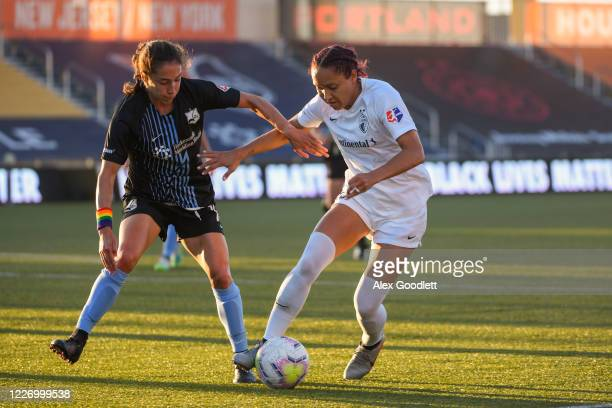 Jalene Daniels of North Carolina Courage attempts to drive around Sabrina Flores of Sky Blue FC during a game on day 8 of the NWSL Challenge Cup at...