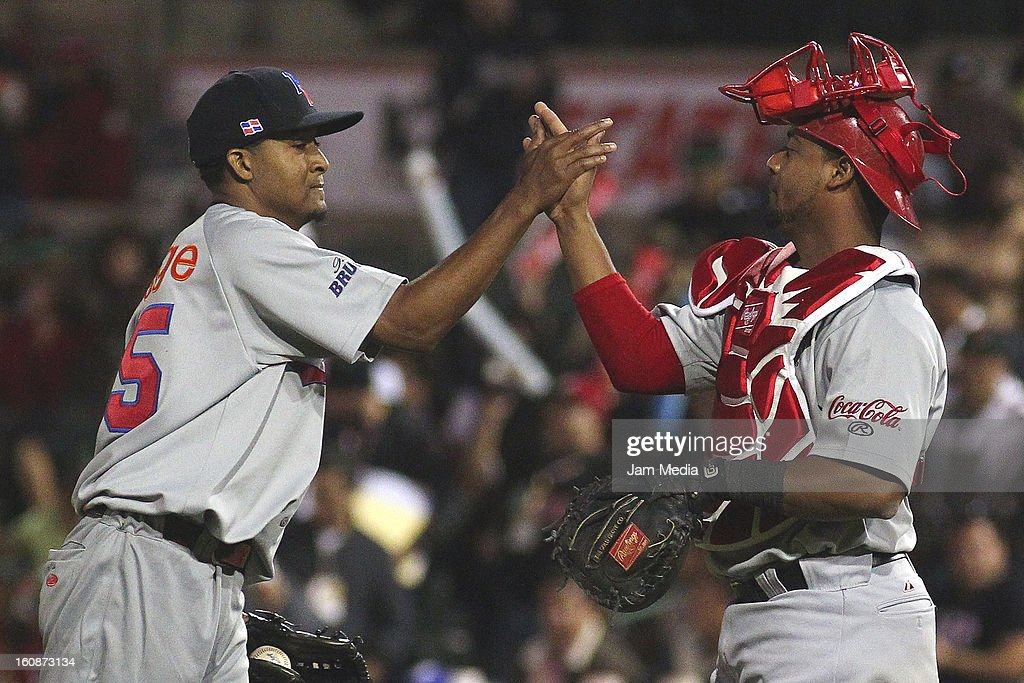 Jalien Paguero and Alberto Rosario of Republica Dominicana celebrate during a match between Republica Dominicana and Venezuela as part of the Caribbean Series 2013 at Sonora Stadium on february 06, 2013 in Hermosillo, Mexico.