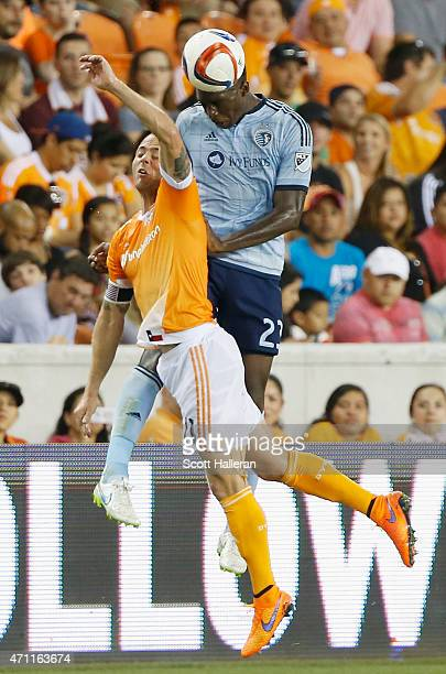 Jalil Anibaba of Sporting KC battles for the ball with Brad Davis of Houston Dynamo during their game at BBVA Compass Stadium on April 25, 2015 in...