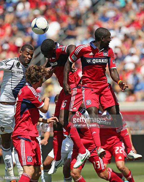 Jalil Anibaba of the Chicago Fire heads the ball away on a corner kick between teammate Dominic Oduro and David Junior Lopes of the Los Angeles...