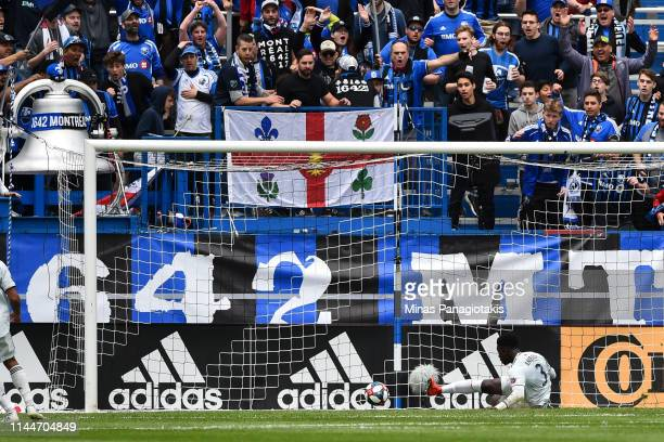 Jalil Anibaba of the New England Revolution defends the ball near the net against the Montreal Impact during the MLS game at Saputo Stadium on May 18...