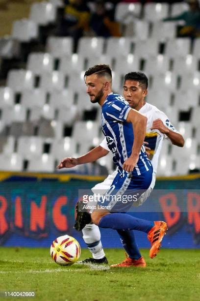 Jalil Elías of Godoy Cruz fights for the ball with Agustín Almendra of Boca Juniors during a first leg round of sixteen match between of Godoy Cruz...