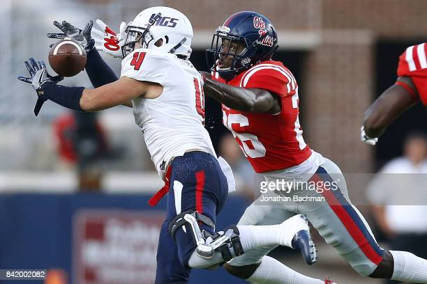 Jalin Buie of the South Alabama Jaguars catches the ball as CJ Moore of the Mississippi Rebels defends during the first half of a game at...
