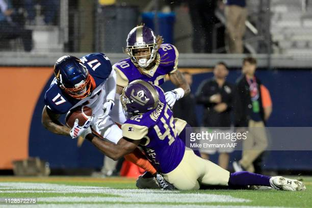 Jalin Marshall of Orlando Apollos scores a second quarter touchdown reception against Carlos Merritt and Quincy Mauger of Atlanta Legends on February...