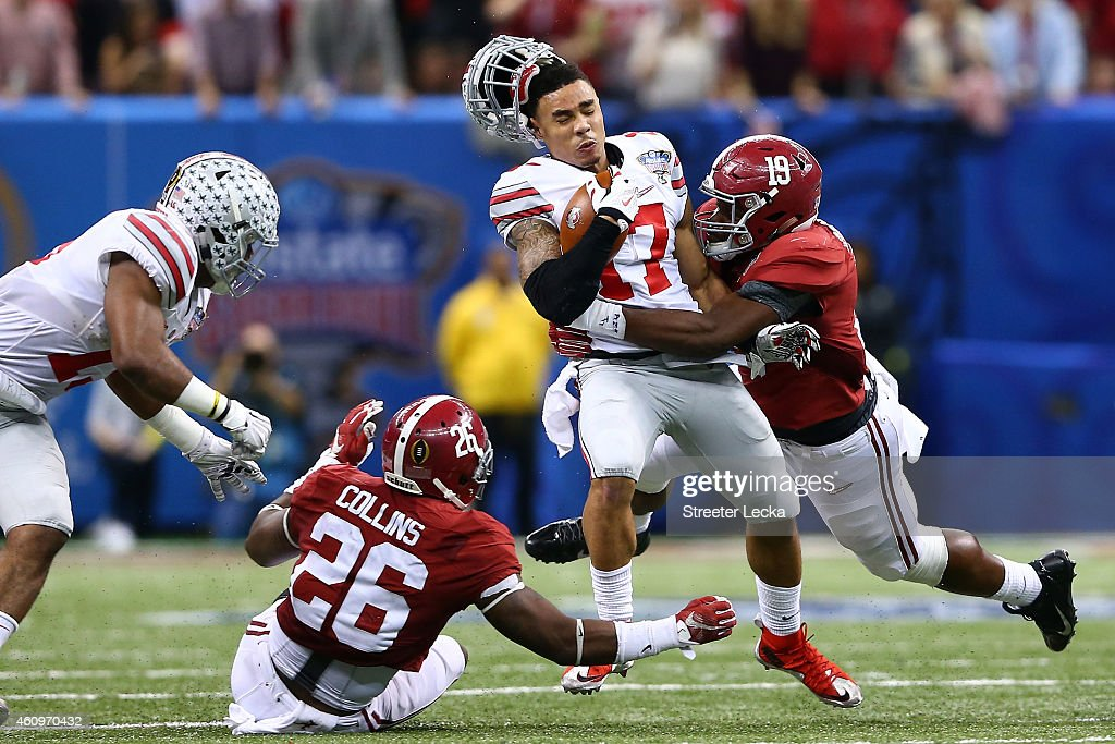 Jalin Marshall #17 of the Ohio State Buckeyes gets tackled Reggie Ragland #19 of the Alabama Crimson Tide during the All State Sugar Bowl at the Mercedes-Benz Superdome on January 1, 2015 in New Orleans, Louisiana.