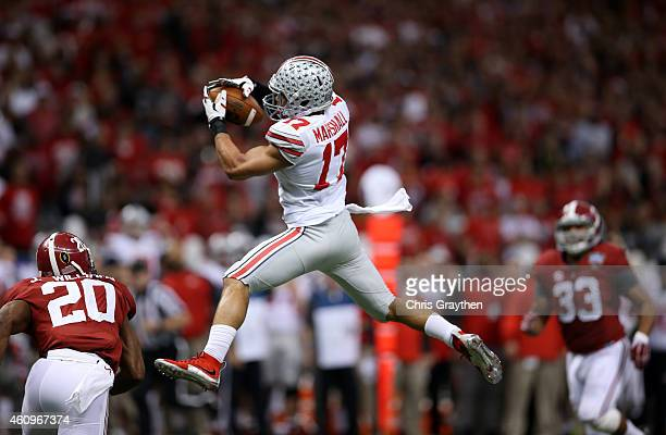 Jalin Marshall of the Ohio State Buckeyes makes a catch over Jarrick Williams of the Alabama Crimson Tide during the All State Sugar Bowl at the...