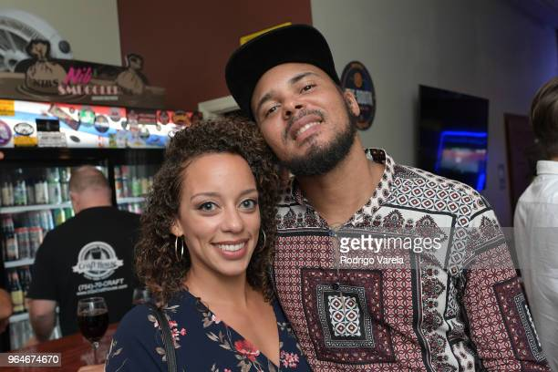 Jalissa Winston and Walshy Fire pose at the Reggae Music Member Mixer on May 31, 2018 in Lauderhill, Florida.