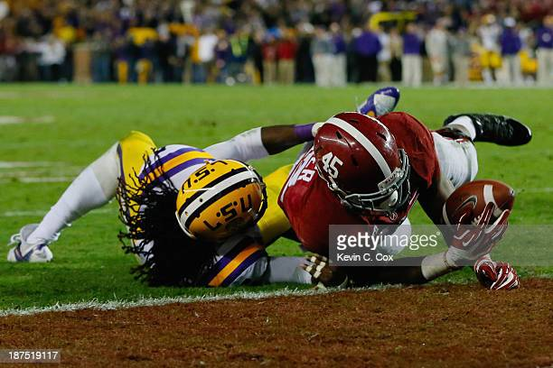 Jalston Fowler of the Alabama Crimson Tide scores a touchdown against Craig Loston of the LSU Tigers in the fourth quarter of the game at BryantDenny...