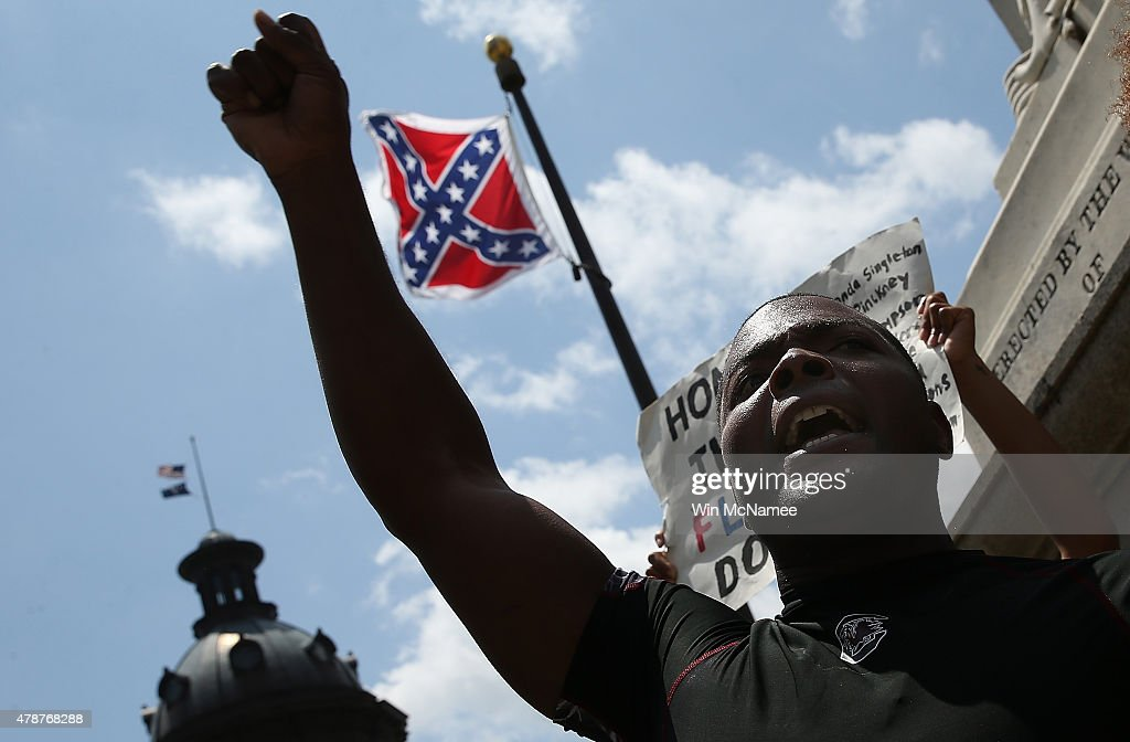 Jaluladin Abdul-Hamib shouts 'Take It Down' while engaging with a group of demonstrators on the grounds of the South Carolina State House calling for the Confederate flag to remain on the State House grounds June 27, 2015 in Columbia, South Carolina. Earlier in the week South Carolina Gov. Nikki Haley expressed support for removing the Confederate flag from the State House grounds in the wake of the nine murders at Mother Emanuel A.M.E. Church in Charleston, South Carolina.
