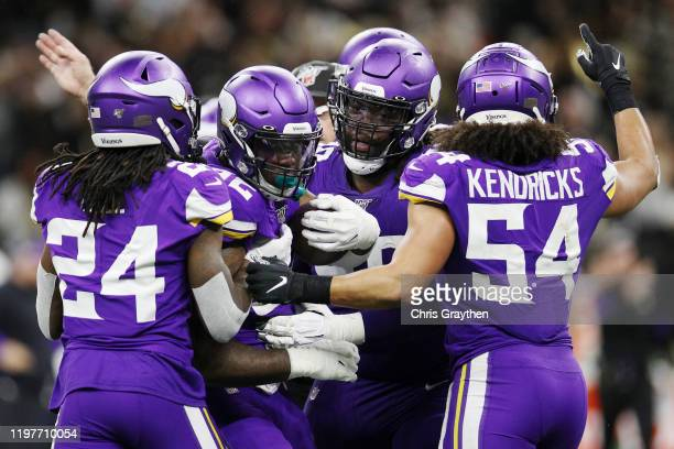 Jalyn Holmes of the Minnesota Vikings celebrates with teammates after recovering a fumble during the fourth quarter against the New Orleans Saints in...