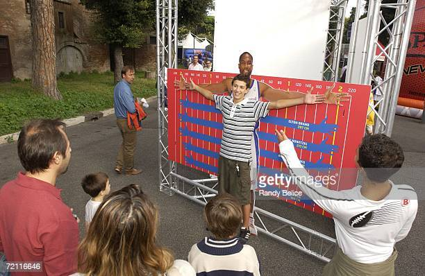 Jam Session visitor compares his arm span to NBA players at the event held at Termi di Caracalla in Rome Italy on October 7 2006 as part of the NBA...