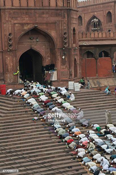 Jama Masjid Mosque with worshipers on steps, Delhi