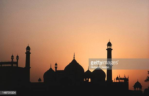 Jama Masjid silhouetted at sunset.