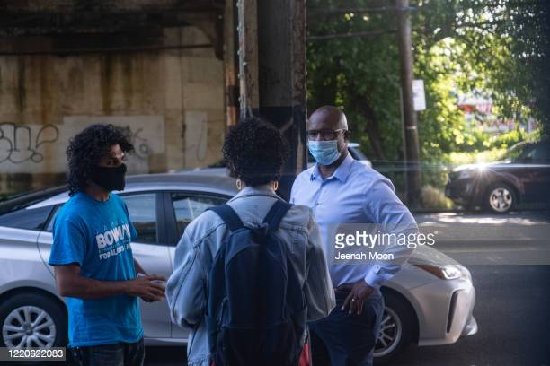 Jamaal Bowman talks with his campaign volunteers outside a subway station on June 17 2020 in the Bronx borough of New York City Bowman is challenging...