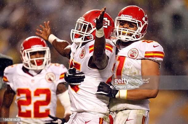 Jamaal Charles of the Kansas City Chiefs celebrates with Dexter McCluster and Tony Moeaki after Charles scored a 12yard rushing touchdown in the...