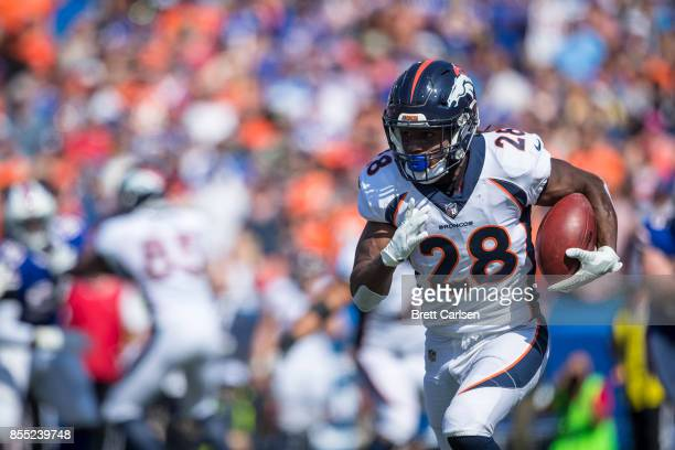Jamaal Charles of the Denver Broncos carries the ball during the first half against the Buffalo Bills on September 24 2017 at New Era Field in...