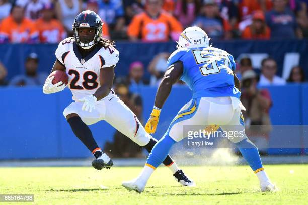 Jamaal Charles of the Denver Broncos cuts back after the catch while being defended by Jatavis Brown of the Los Angeles Chargers during the game at...