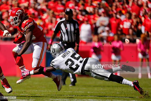Jamaal Charles of the Kansas City Chiefs attempt to avoid the outstretched arms of D.J. Hayden of the Oakland Raiders in the second quarter October...