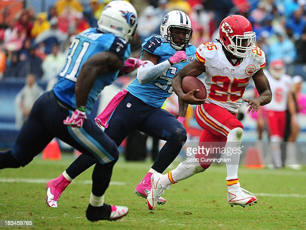 Jamaal Charles of the Kansas City Chiefs carries the ball against the Tennessee Titans at LP Field on October 6 2013 in Nashville Tennessee