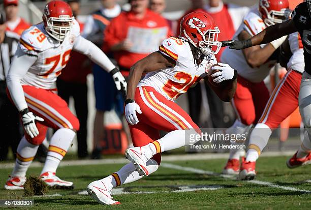 Jamaal Charles of the Kansas City Chiefs carries the ball against the Oakland Raiders during the first quarter at O.co Coliseum on December 15, 2013...