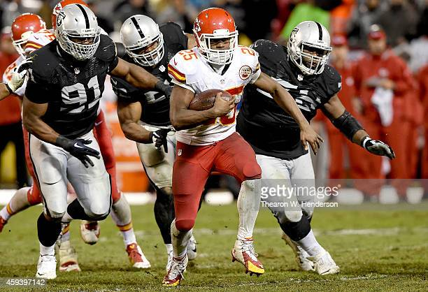 Jamaal Charles of the Kansas City Chiefs carries the ball against the Oakland Raiders during the second quarter at O.co Coliseum on November 20, 2014...