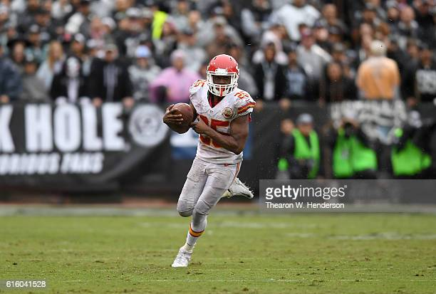 Jamaal Charles of the Kansas City Chiefs carries the ball against the Oakland Raiders during an NFL football game at OaklandAlameda County Coliseum...