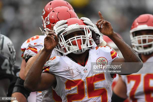 Jamaal Charles of the Kansas City Chiefs celebrates after a fouryard touchdown against the Oakland Raiders during their NFL game at OaklandAlameda...