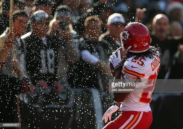 Jamaal Charles of the Kansas City Chiefs celebrates after scoring a touchdown against the Oakland Raiders at O.co Coliseum on December 15, 2013 in...