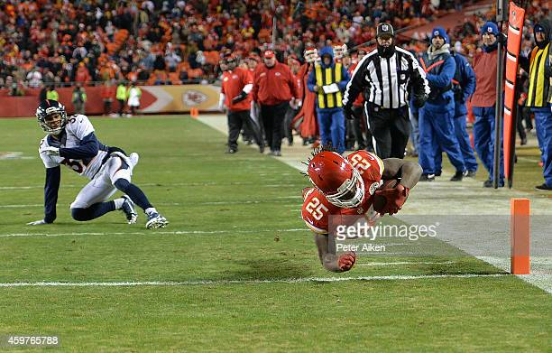 Jamaal Charles of the Kansas City Chiefs dives into the endzone for a touchdown as Tony Carter of the Denver Broncos defends during the game at...