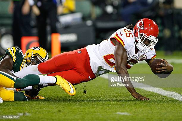 Jamaal Charles of the Kansas City Chiefs leaps toward the endzone for a touchdown in the second quarter against the Green Bay Packers at Lambeau...