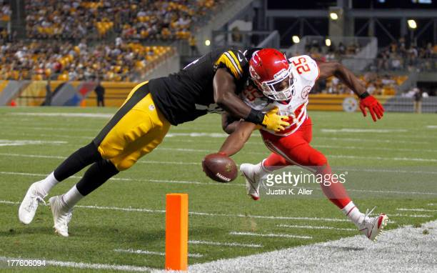 Jamaal Charles of the Kansas City Chiefs reaches for the pylon against Lawrence Timmons of the Pittsburgh Steelers in the first half during the game...