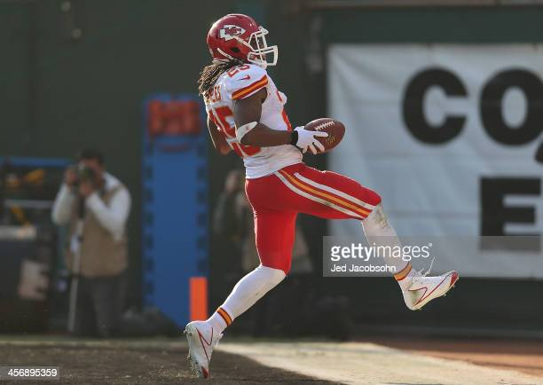 Jamaal Charles of the Kansas City Chiefs runs for a touchdown against the Oakland Raiders at Oco Coliseum on December 15 2013 in Oakland California