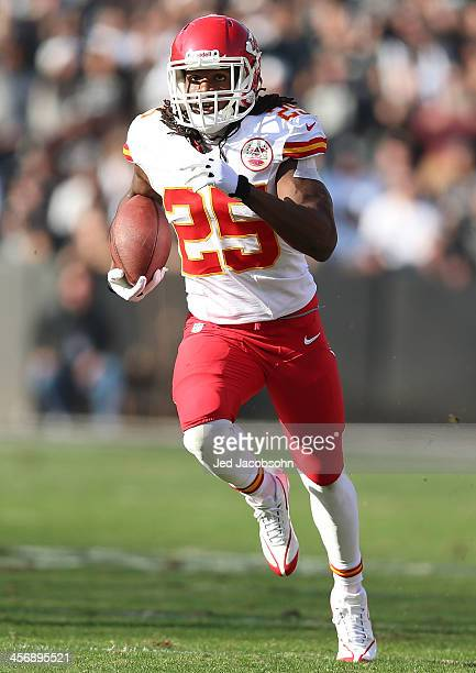 Jamaal Charles of the Kansas City Chiefs runs for a touchdown against the Oakland Raiders at O.co Coliseum on December 15, 2013 in Oakland,...