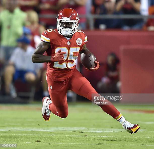 Jamaal Charles of the Kansas City Chiefs runs the ball against the New England Patriots during the game at Arrowhead Stadium on September 29 2014 in...