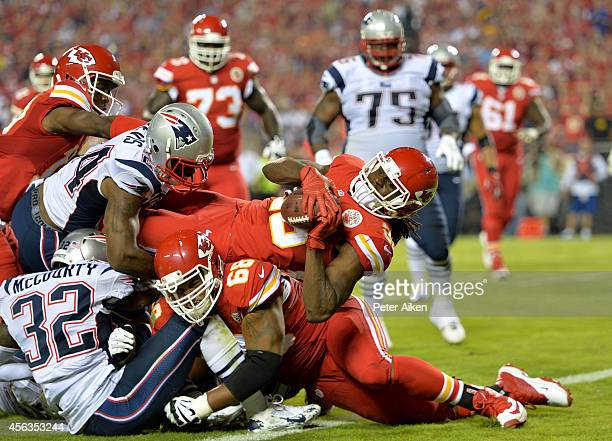 Jamaal Charles of the Kansas City Chiefs scores a touchdown against the New England Patriots during the second quarter at Arrowhead Stadium on...