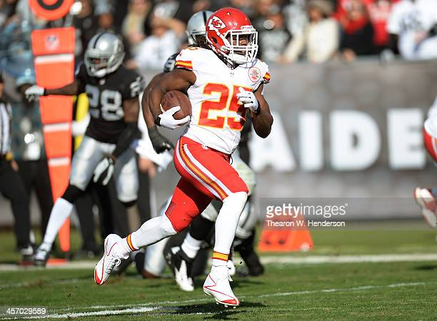 Jamaal Charles of the Kansas City Chiefs scores on a thirty nine yard sceen play against the Oakland Raiders during the first quarter at O.co...