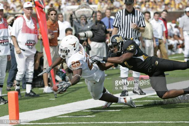 Jamaal Charles of the Texas Longhorns dives in for an apparent touchdown but fumble the ball prior to getting in the end zone against the Missouri...
